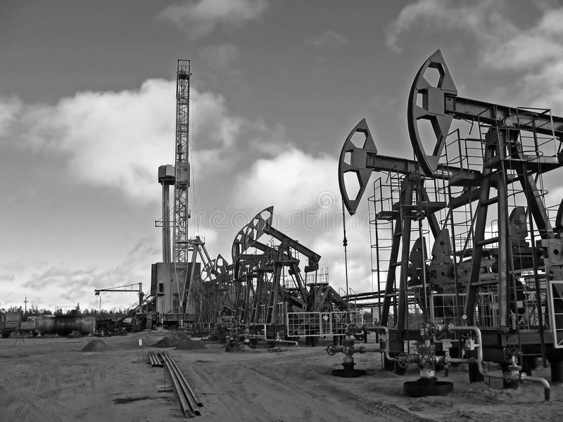 Borehole. Work of oil industry. Construction and equipment of pump jack. Black and white photo royalty free stock photos