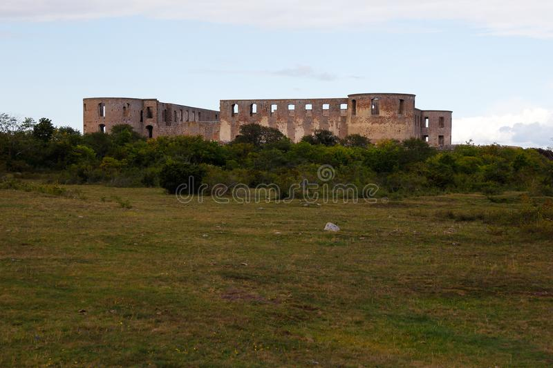 Borgholm castle ruin. A distant view of Borgholm Castle ruins located near the town Borgholm in the Swedish province of Oland stock photos
