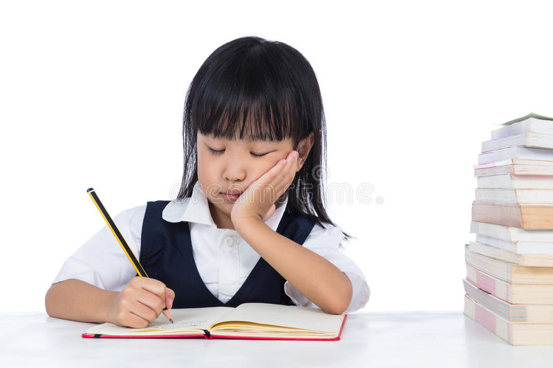 Boring Asian Chinese little girl wearing school uniform studying royalty free stock photos