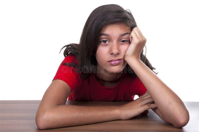 Boring brunette teenage girl. On white backgroud stock photography