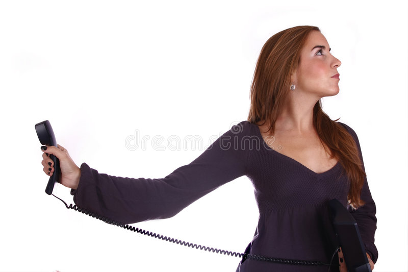 Boring conversation. Woman with a phone, bored/angry with the conversation stock photo