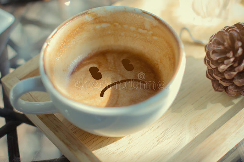 Boring face cup of coffee royalty free stock image