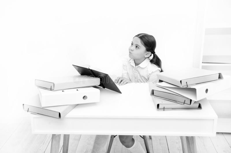 Boring lesson. Boring task homework. Get rid of boring task. Girl bored pupil sit at desk with folders and books. Issues. Of formal education. Back to school royalty free stock image