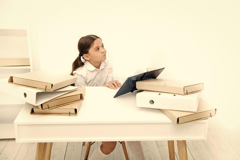 Boring lesson. Boring task homework. Get rid of boring task. Girl bored pupil sit at desk with folders and books. Issues. Of formal education. Back to school royalty free stock photography