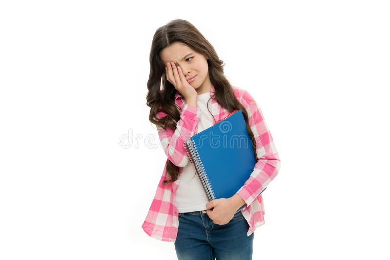 Boring lesson. Tired kid. Providing books for primary school. Adorable little girl with school exercise book. Cute small royalty free stock image