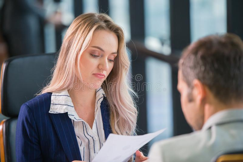 Boring office employee worker, Business Manager women bore her male partner not professional working royalty free stock image