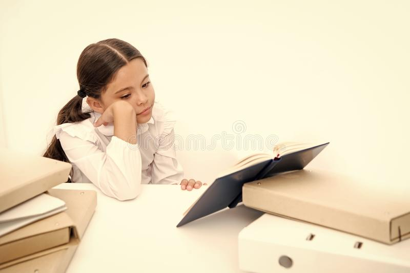Boring task homework. Get rid of boring task. Girl bored pupil sit at desk with folders and books. Issues of formal. Education. Back to school concept. Kid cute royalty free stock photography