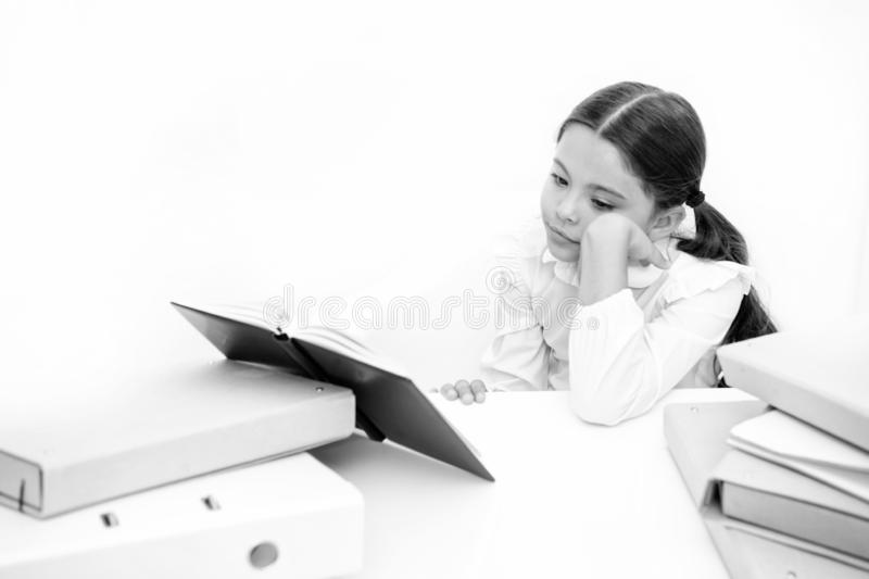 Boring task homework. Get rid of boring task. Girl bored pupil sit at desk with folders and books. Issues of formal. Education. Back to school concept. Kid cute stock photos