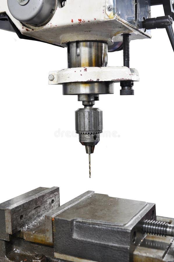 Boringsmachine, Industriële Ijzerboor in actie in de close-up van de staalfabriek op de boor stock foto