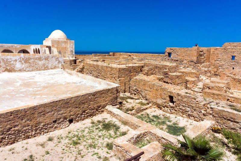 Borj el Kebir Castle View in Houmt El Souk in Djerba, Tunisia. Borj el Kebir Castle with background of Mediterranean sea in Houmt El Souk in Djerba, Tunisia stock photography