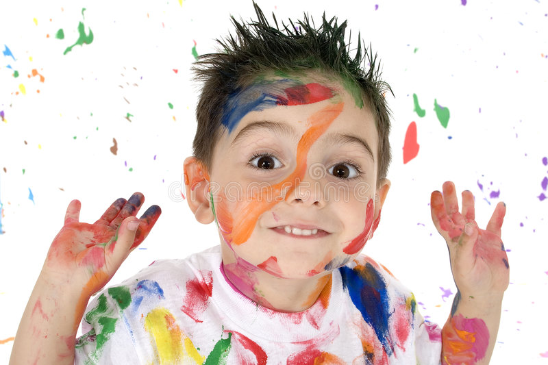 Born Artist. Adorable 3 year old boy covered in bright paint