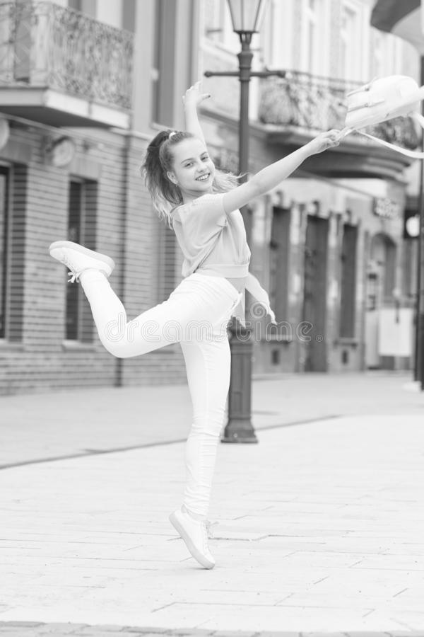 Born a dancer. Little female dancer performing choreography on street. Small cute girl dancer dancing tip toe on summer stock image
