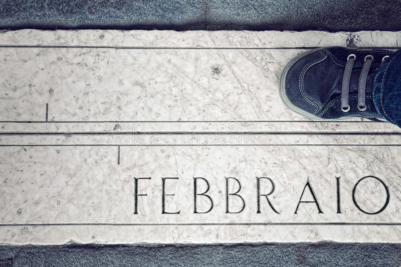 Born in February. Baby born in February , indicated that date with leg royalty free stock image