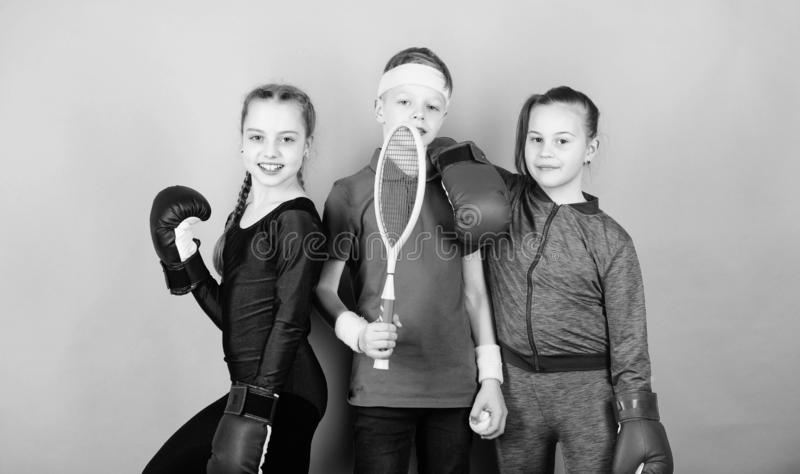 Born to fight. Happy children in boxing gloves with tennis racket and ball. Fitness energy health. punching knockout. Team sport success. workout of small stock images