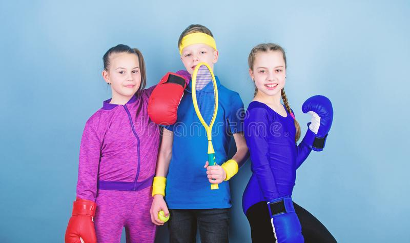 Born to fight. Happy children in boxing gloves with tennis racket and ball. Fitness energy health. punching knockout. Team sport success. workout of small stock photos