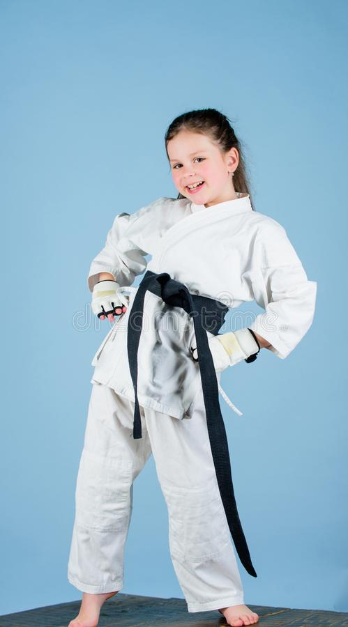 Born to fight. practicing Kung Fu. happy childhood. small girl in martial arts uniform. sport success in single combat stock photos