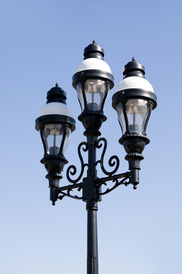 Borne ornamentado da lâmpada com três luzes foto de stock royalty free