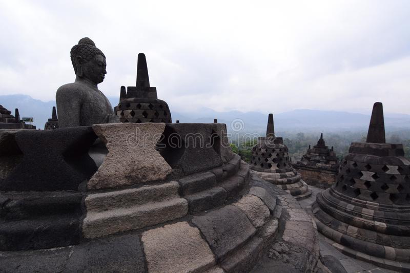 Borobudur stupas overlooking the mountains. Magelang. Central Java. Indonesia. Borobudur, or Barabudur, is a 9th century Mahayana Buddhist temple in Magelang stock photo