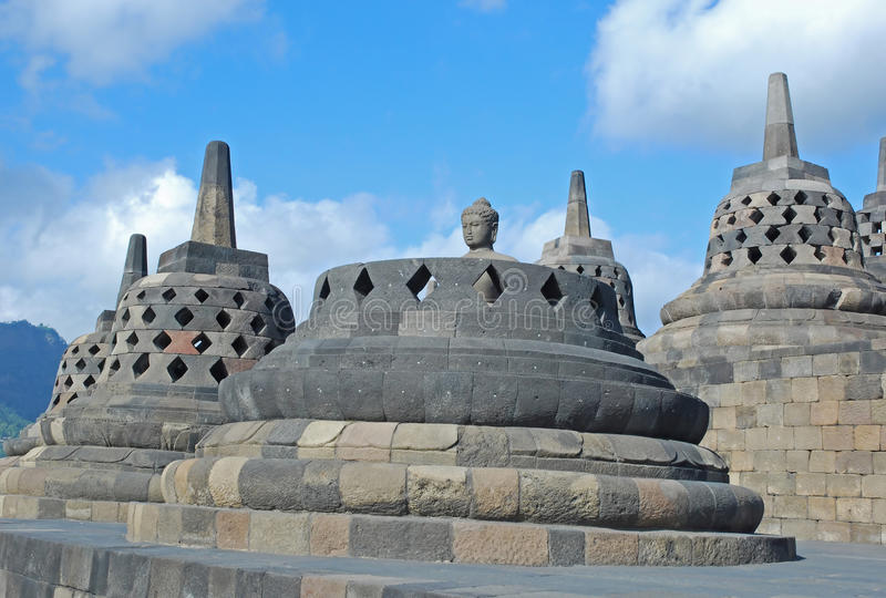 Borobudur - Perforated stupa's with Buddha statue. Perforated stupa's with Buddha statue on upper platform , Borobudur or Barabudur, a 9th-century Mahayana royalty free stock photography
