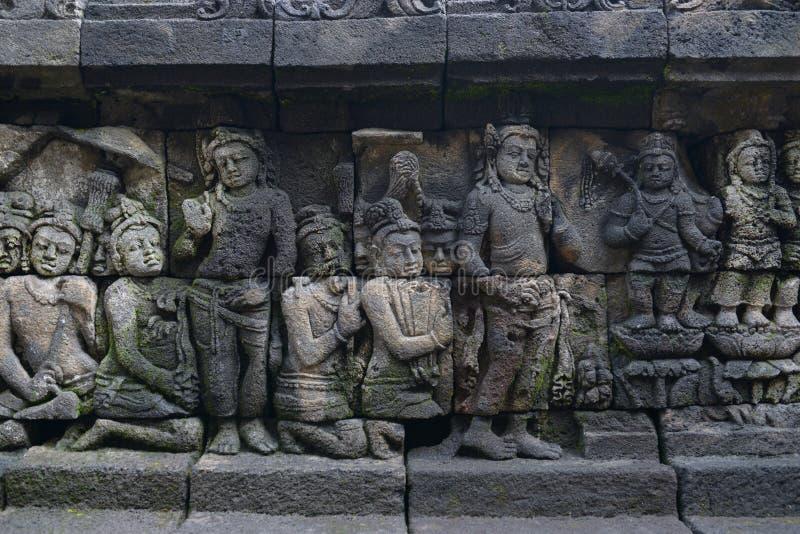 Borobudur sul fondo dei dettagli della parete immagini stock libere da diritti