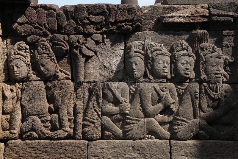 Borobudur Temple, Central Java, Indonesia. Ascetic men. Stone bas relief from the Borobudur Temle in Central Java, Indonesia royalty free stock photography