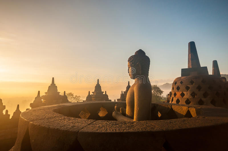 Borobudur Temple. At sunrise, Yogyakarta, Java, Indonesia. (silhouette scene stock photos