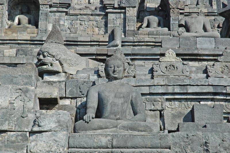 Borobudur - Wall with Buddha statue's. Borobudur or Barabudur, Wall with Buddha statue's, 9th-century Mahayana Buddhist temple in Magelang, Central Java royalty free stock photos