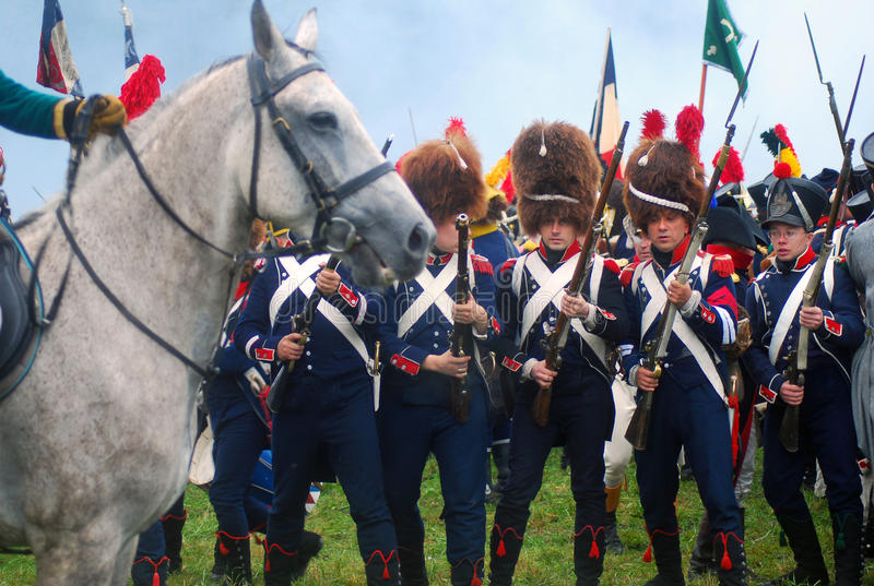 Borodino 2012 historical reenactment. MOSCOW REGION - SEPTEMBER 02: Unknown soldiers holding bayonets, white horse profile at Borodino historical reenactment royalty free stock photos