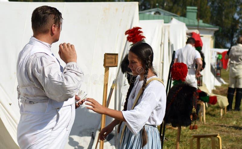 Reenactors at French camp at Borodino battle historical reenactment in Russia. BORODINO, MOSCOW REGION, RUSSIA - SEPTEMBER 01, 2019: Reenactors at French camp at stock images