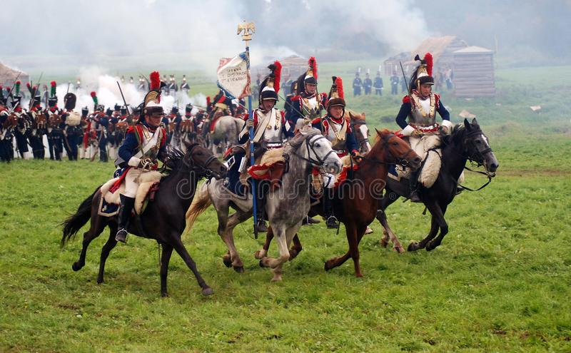 Cuirassiers at Borodino battle historical reenactment in Russia. BORODINO, MOSCOW REGION - SEPTEMBER 04, 2016: Reenactors dressed as Napoleonic war soldiers stock image