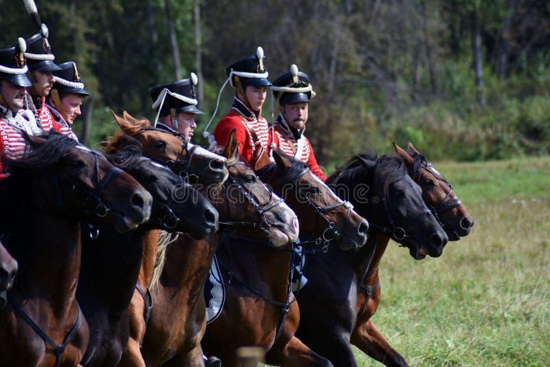 Reenactors horse riders at Borodino battle historical reenactment in Russia. BORODINO, MOSCOW REGION - SEPTEMBER 02, 2018: Reenactors horse riders at Borodino royalty free stock image