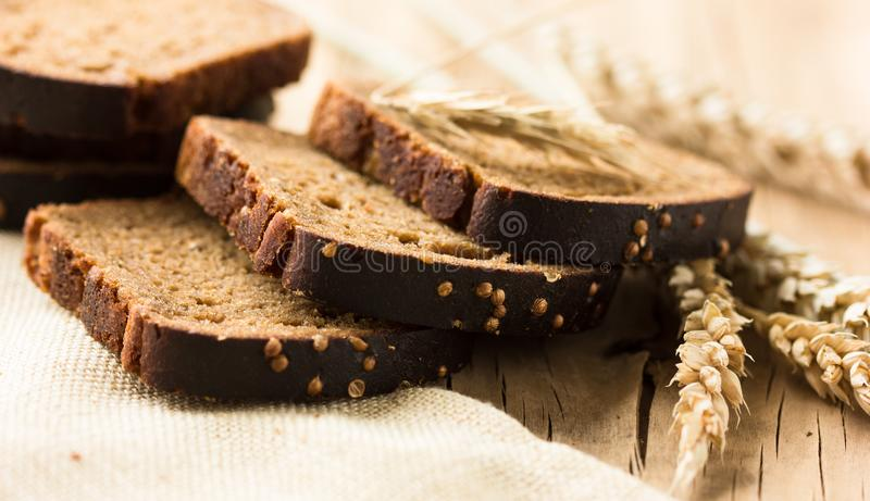 Borodinsky bread slice is a traditional Russian rye-wheat bread with maltose syrup malt and coriander royalty free stock photography