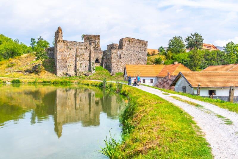 Borotin Castle ruins with romantic pond in the foreground, Borotin, South Bohemia, Czech Republic.  stock image