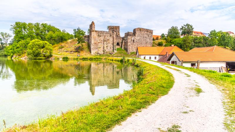 Borotin Castle ruins with romantic pond in the foreground, Borotin, South Bohemia, Czech Republic.  royalty free stock photo