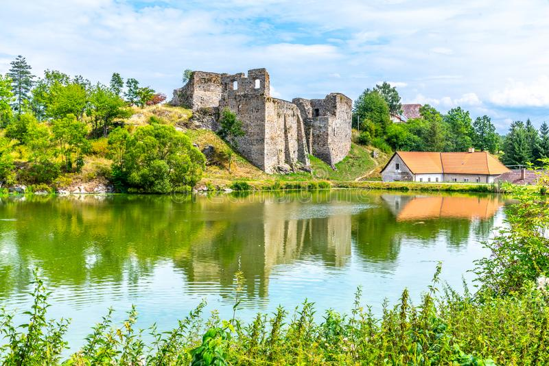 Borotin Castle ruins with romantic pond in the foreground, Borotin, South Bohemia, Czech Republic.  royalty free stock photography