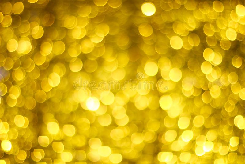 Borrão dourado de Bokeh Luzes de brilho do ouro Círculos de Bokeh ilustração do vetor