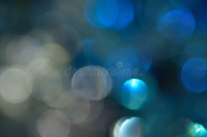 Borrado, o bokeh ilumina o fundo. Sparkles do sumário fotos de stock royalty free