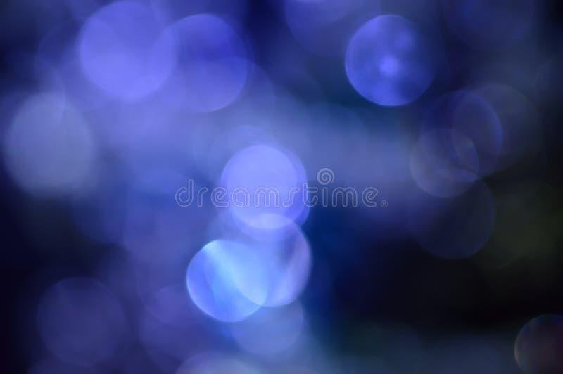 Borrado, o bokeh ilumina o fundo. Sparkles do sumário imagens de stock