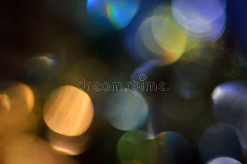 Borrado, o bokeh ilumina o fundo. Sparkles do sumário imagens de stock royalty free