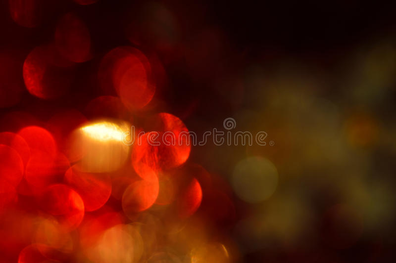 Borrado, o bokeh ilumina o fundo. Sparkles do sumário imagem de stock