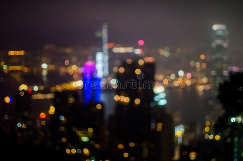 Borre o prédio de escritórios leve da cidade de Hong Kong da opinião da noite, fundo abstrato foto de stock