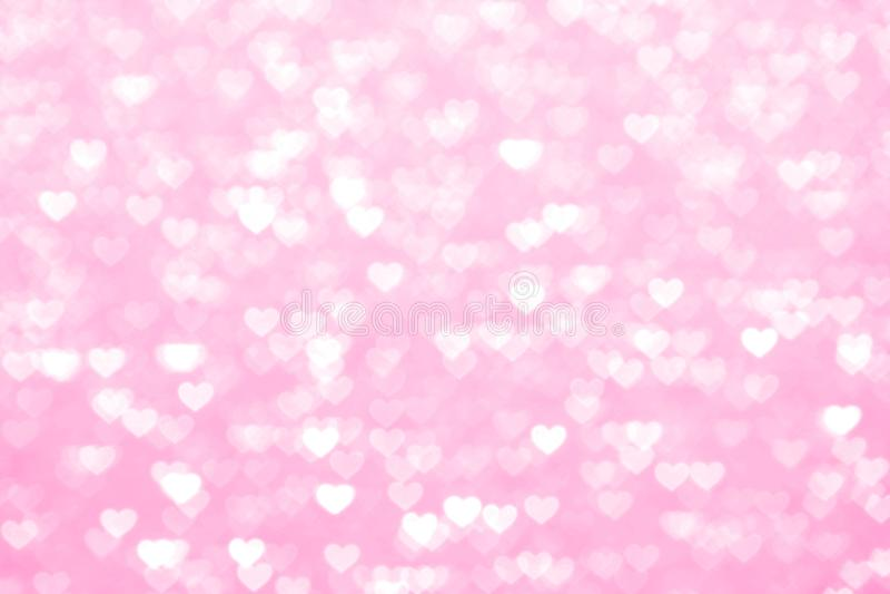Borre romântico bonito do fundo do rosa do coração, rosa macio da máscara pastel do coração das luzes do bokeh do brilho, rosa co foto de stock