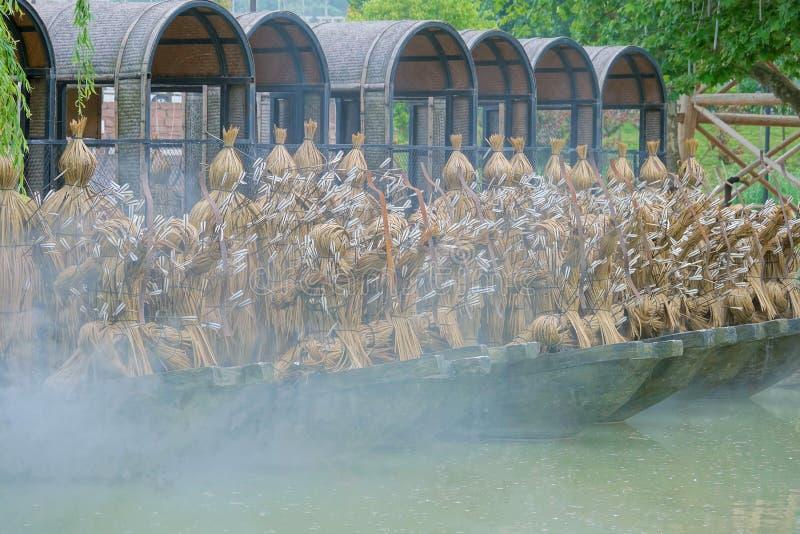 Borrow pijlen met met stro bedekte boten stock afbeelding