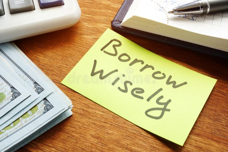 Borrow Wisely sign and money. Choose loan concept. Borrow Wisely inscription and money. Choose loan concept royalty free stock images
