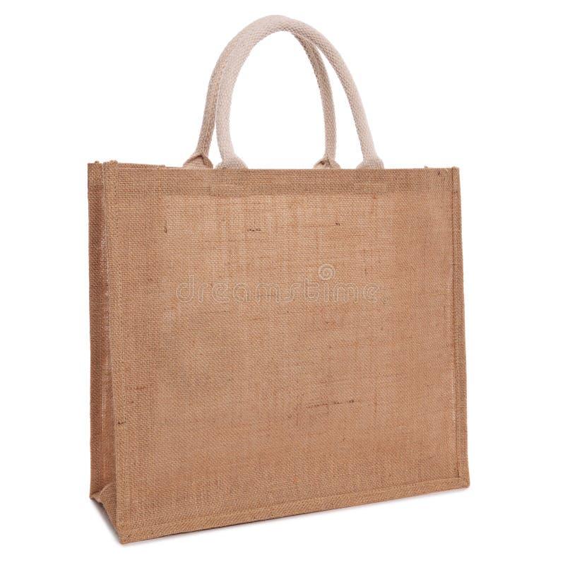 Borsa di acquisto riciclata del sacco della tela di iuta isolata su bianco immagine stock
