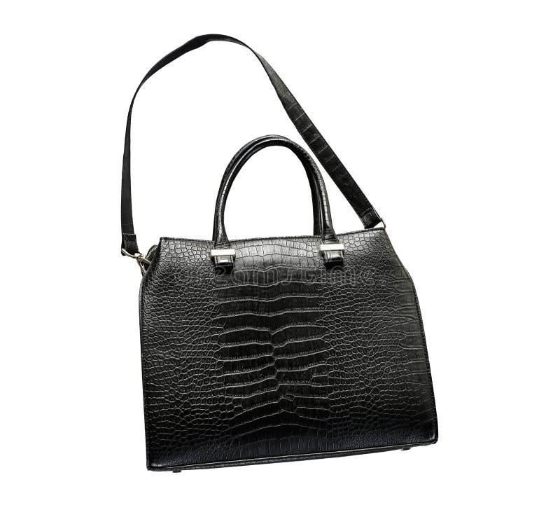 Borsa femminile del bello nero di cuoio nero di lusso del coccodrillo su un fondo bianco fotografie stock