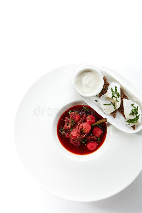 Borscht or Borsch Served with Salted Lard on Black Bread royalty free stock photo