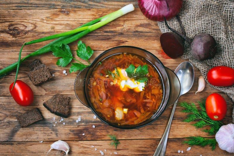 Borscht, healthy dinner, top view, wooden table stock image