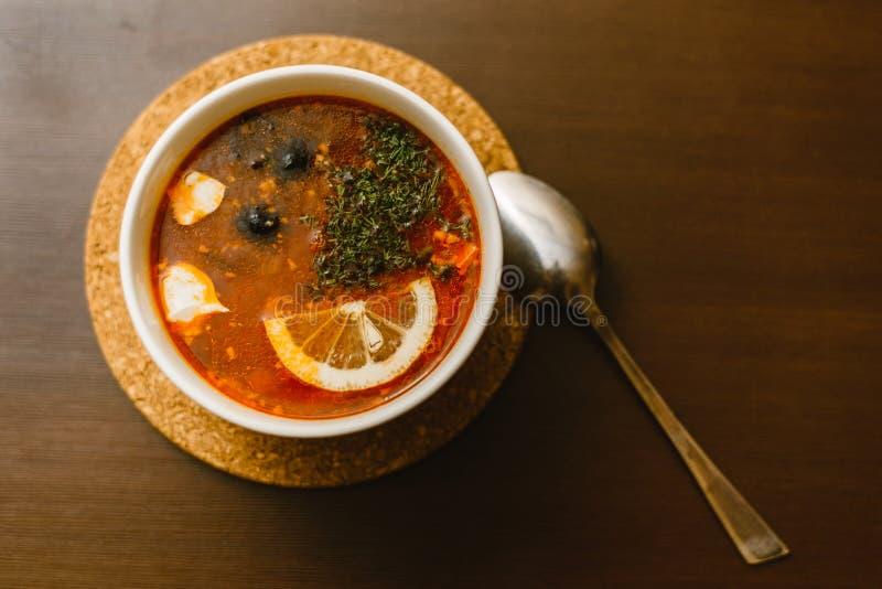 borscht, solyanka with lemon royalty free stock image