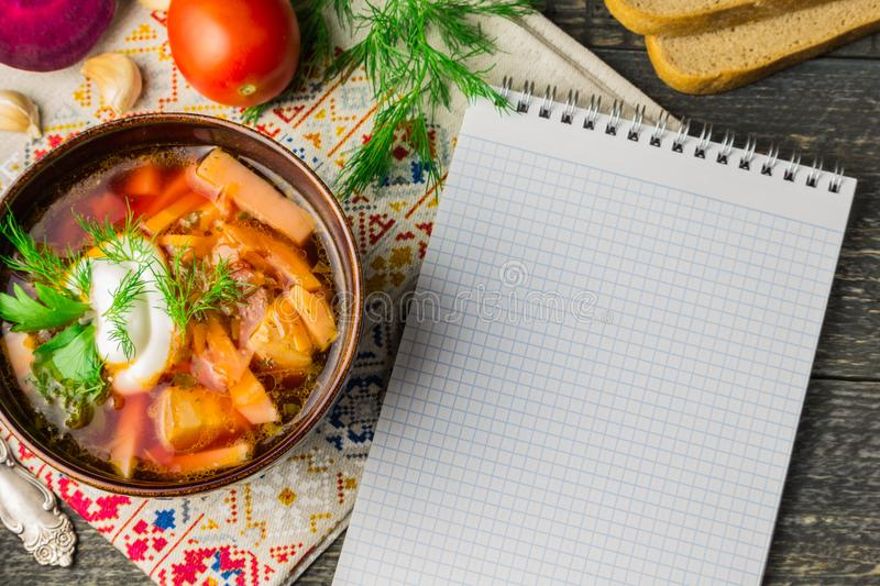Borshch is a home-made Russian, Ukrainian national soup. Bread, beets, vegetables meat with sour cream on grey wooden stock image